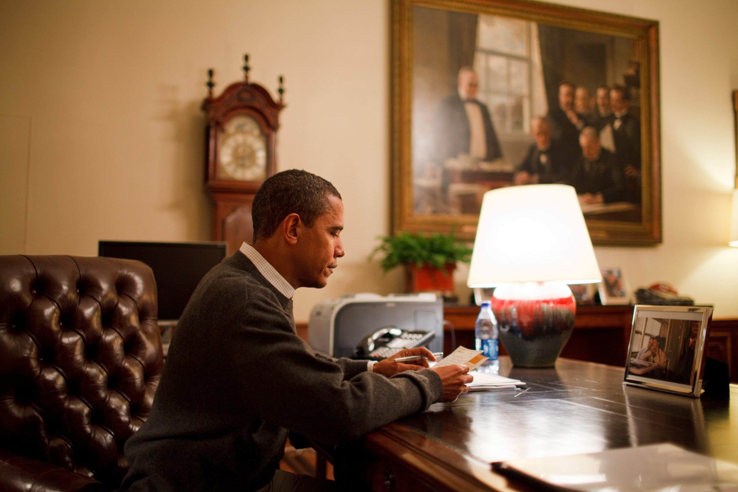 Barack Obama reads letters from citizens. White House photo by Pete Souza